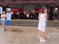 Children Dancing at a Concert in the Park